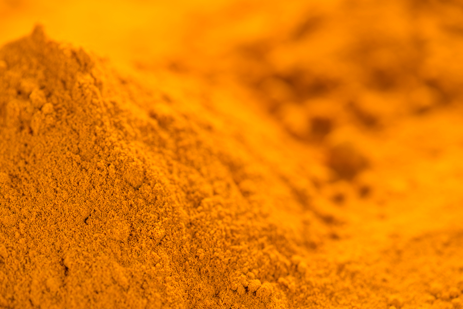 Portion of Turmeric (close-up shot) for use as background image or as texture